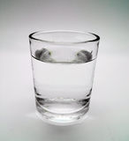Glass of water on isolated Stock Photos