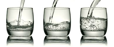 Glass with a water jet. Clipping path is included Royalty Free Stock Photo