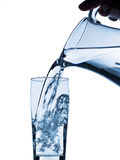 Glass with water and jug Royalty Free Stock Photos