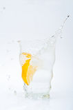 Glass of water with lemon Stock Images