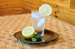 Glass of water with a lemon Royalty Free Stock Photography