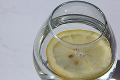 Glass of water with lemon, lemonade, white background Royalty Free Stock Images