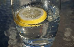 Glass of water and lemon stock photos