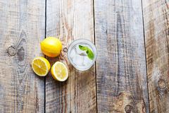 Glass of water with lemon and mint on wooden table Royalty Free Stock Photography