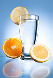 Glass of water, lemon and orange Stock Image