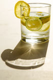 Glass of water with lemon slice Royalty Free Stock Photos
