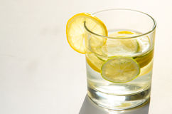 Glass of water with lemon slice Royalty Free Stock Images