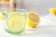 Glass of water with lemon slice. On table stock photography