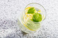 Glass with water with lemon slices Stock Photo
