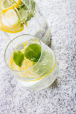 Glass with water with lemon slices Royalty Free Stock Photo