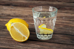 Glass of water with lemon slices. On a wooden background. Copy space. Free space for text Royalty Free Stock Image