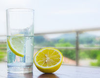 Glass of water with lemon. On white background Royalty Free Stock Images
