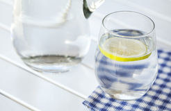 Glass of water with lemon on white background Stock Photography