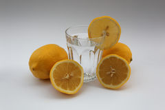 Glass of water with lemons Stock Image