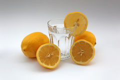 Glass of water lemons Royalty Free Stock Image
