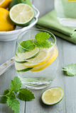 Glass of water with lime and lemon Stock Photo