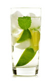 Glass of water with lime and mint on white Royalty Free Stock Images