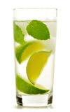 Glass of water with lime and mint on white Stock Photo
