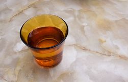 A glass of water on a marble table. A glass of water on a marble table in the House Royalty Free Stock Images