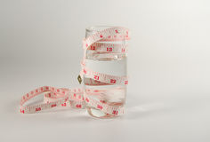 Glass water with measure tape Stock Photo