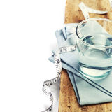 Glass of water and  measuring tape Stock Images
