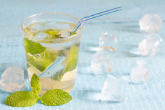 Glass of water with mint and ice cubes Stock Photo