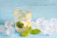 Glass of water with mint and ice cubes Stock Photography