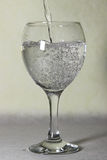 A glass of water. A glass with moving water Royalty Free Stock Photo