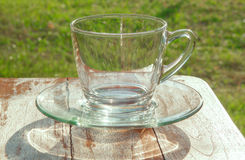 Glass of water on nature background,sunshine,sunlight Royalty Free Stock Images