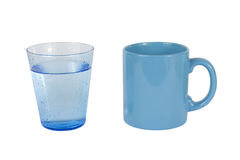 A glass of water and one cup Royalty Free Stock Photo