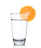 Glass of water with orange fruit Stock Photos