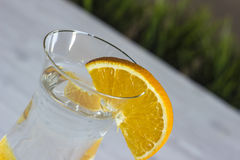 Glass of water with orange on a white background. With grass Royalty Free Stock Images