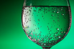 Glass of Water over green background Stock Photography