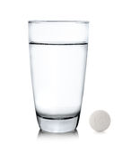 Glass of water and pills isolated on white background Royalty Free Stock Images