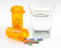 Glass of water with pills Stock Photo