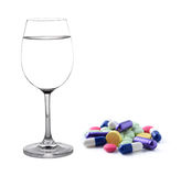 Glass of water and pills Stock Photography