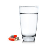Glass of water and pills  on white background Stock Images