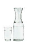 Glass of water and pitcher. On white background Stock Photography
