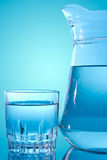 Glass and water pitcher Stock Images