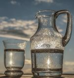 Water in a glass and in a Pitcher. Stock Photography