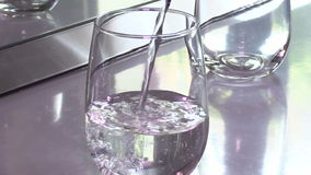 Glass of water stock video