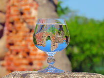 A glass of water on the ruins. Of an ancient fortress Stock Photos