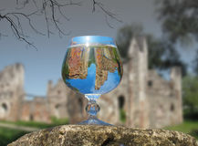 A glass of water on the ruins. Of an ancient fortress Stock Image