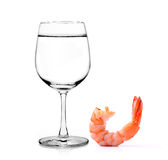 Glass of water and shrimps  on white background Royalty Free Stock Image