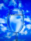 Glass of water on sky Stock Images