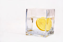 Glass of water with a slice of lemon Stock Images