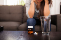Glass of water and some pills Royalty Free Stock Photo