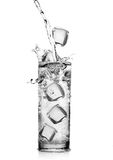 Glass of water with a splash Stock Photos