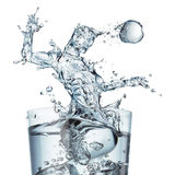 Glass of water with splash as a soccer player stock photography