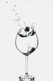 Glass of water. Splash water and ice in a glass transparent Royalty Free Stock Photos